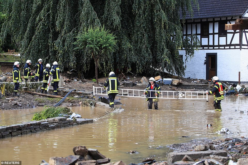 Firefighters work at a flood-affected area following heavy rainfalls in Schuld, Germany