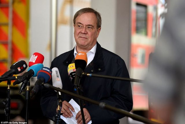 Armin Laschet, State Premier of North Rhine-Westphalia, speaks to the media after flooding in his state and neighbouring Rhineland-Palatinate left at least 20 dead and 70 missing