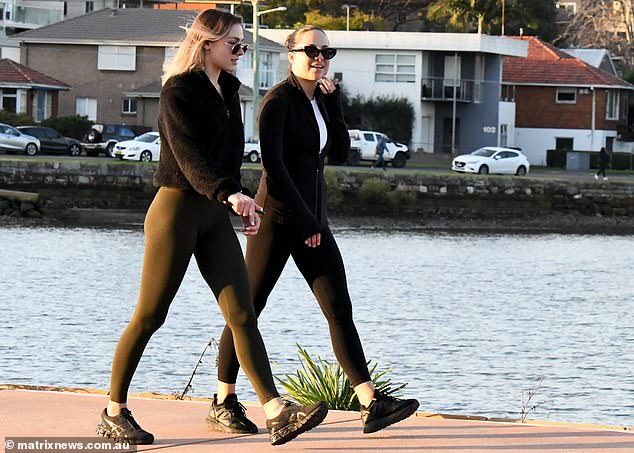 Exercising outside is completely safe, said Ms Berejiklian, and hasn't caused a single case of transmission so far (pictured, two women on Sydney's Bay Run)