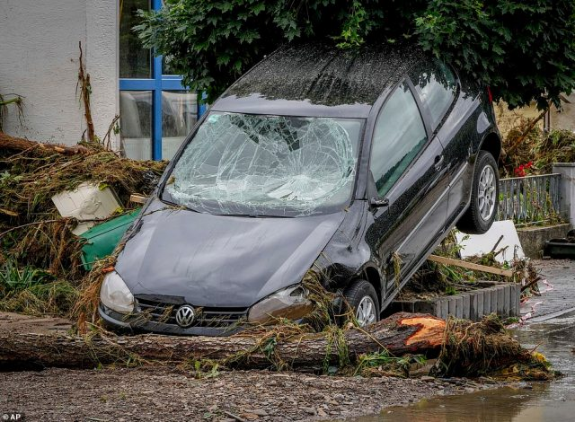 A damaged car is seen in Insul at the Ahr river, western Germany, after being swept away in the flood