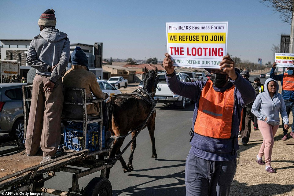 Vigilantes have said they are 'prepared to die' defending shops from looters amid protests against riots in Soweto as South Africa's lawlessness entered its seventh consecutive day