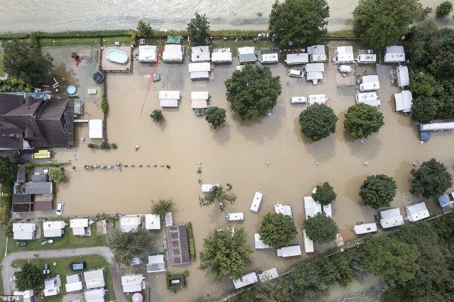 SWITZERLAND:Tents and caravans stand on the flooded Reussbruecke campsite, in Ottenbach, Switzerland