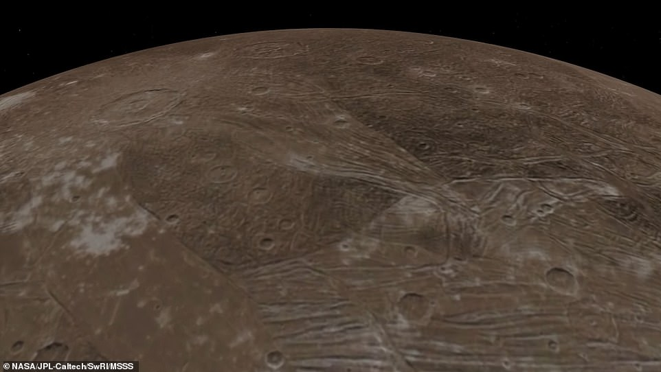 The imagery shows several of the moon's dark and light regions, which are believed to result from ice sublimating as well as the crater Tros, which is among the largest and brightest crater scars on Ganymede