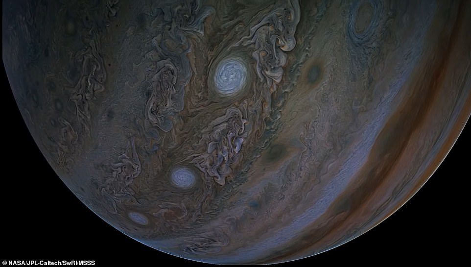 Juno also captured Jupiter's five of the gas giant's 'string of pearls' (pictured) ¿ eight massive storms rotating counterclockwise in the southern hemisphere that appear as white ovals