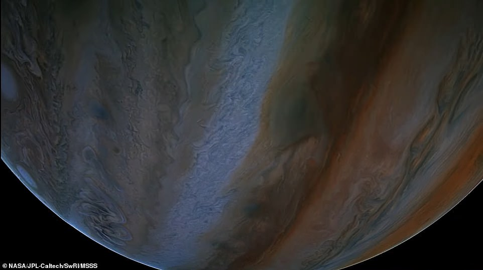 Viewers are transported just 2,100 miles above Jupiter's breathtaking cloud tops (pictured), which is a point where the giant planet's powerful gravity has accelerated the spacecraft to almost 130,000mph