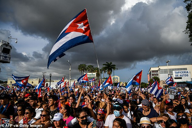 People protest to show support for Cubans demonstrating against their government in Miami