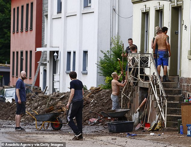 Men clear up the damage aftersevere rainstorms and flash floods hit western states of Rhineland-Palatinate and North Rhine-Westphalia in Germany