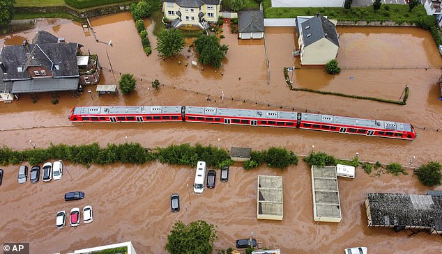 A train sits in the flood waters at the local station in Kordel, Germany, after a nearby river burst its banks and covered the tracks