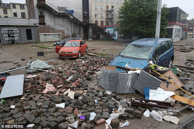 Vehicles and wreckage are seen on the street, following heavy rainfalls in Verviers, Belgium
