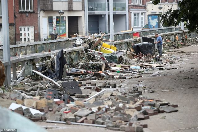 Debris swept along by the La Vestre river is seen dumped on the bank in Verviers, Belgium, after floodwaters receded