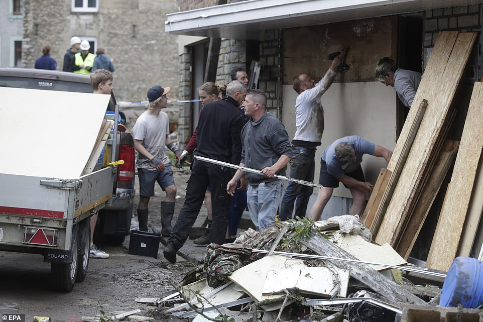 Residents clean up after heavy rains had caused severe flooding in Ensival, Verviers, Belgium