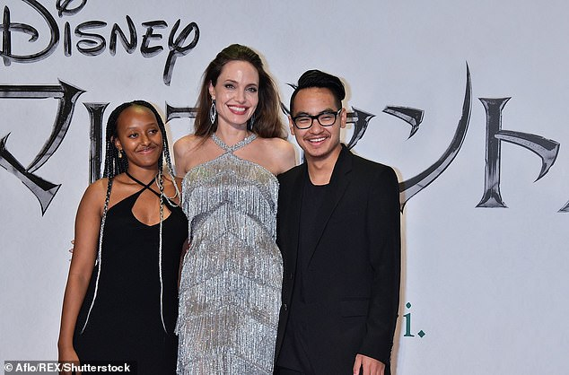 Documentary: An upcoming documentary exploring the potentially unethical practices used in Cambodian adoptions will explore whether Angelina Jolie's son Maddox 'may have been stolen from his birth family (Jolie pictured with daughter Zahara and son Maddox in 2020)