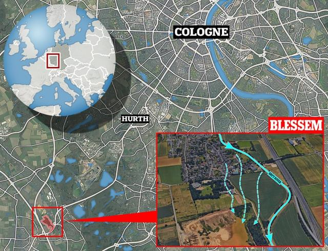 The collapse happened in Blessem, south of Cologne (main), when flooding from the Erft river caused waterlogged ground to collapse into a nearby gravel pit (inset) - dragging homes and cars down with it