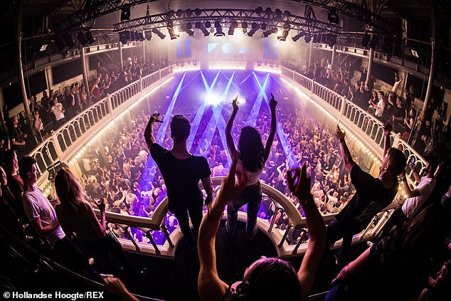 Holland has seen a spike in cases in recent weeks, after the government scrapped most restrictions on June 26 (Pictured: Amsterdam's Paradiso reopens to a full crowd on June 26)
