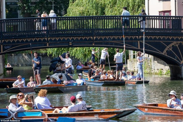People out punting on the River Cam in Cambridge this morning at the start of a hot weekend