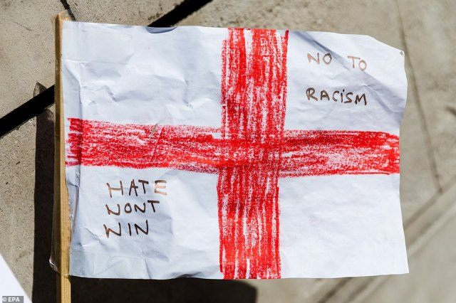 A St. George's flag seen on the floor at the Stand Up To Racism demonstration in London this afternoon