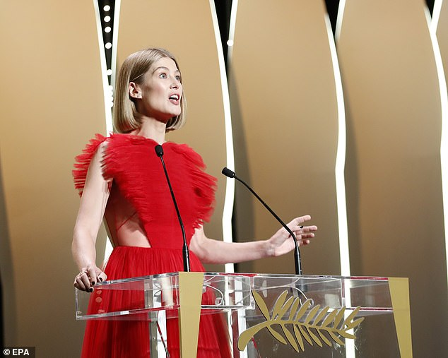 Host with the most: Rosamund was seen talking to the audience during the awards show