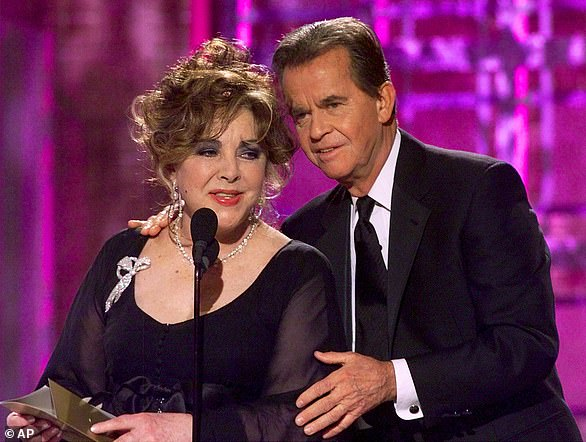 While presenting the award for Best Motion Picture Drama, Elizabeth Taylor opened the envelope before naming the nominees butproducer Dick Clark stopped her in time