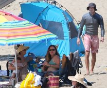 Leighton Meester relaxes along with her youngsters on the seaside whereas Adam Brody goes browsing