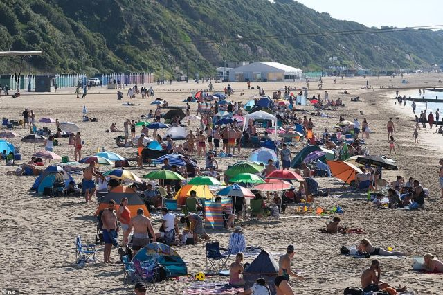 Visitors arrive to Bournemouth beach to enjoy the sizzling weather as the nations sees spells of warm sunshine break through