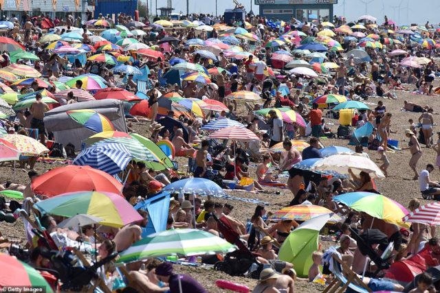 Crowds gather to enjoy the warm sunny weather on Jubilee beach today in Southend-on-Sea