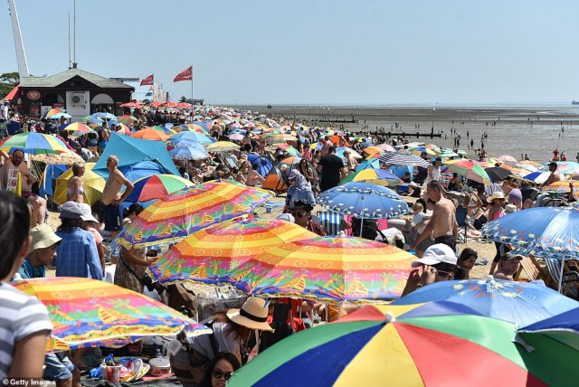 Crowds gather to enjoy the warm sunny weather on Jubilee beach in Southend-on-Sea
