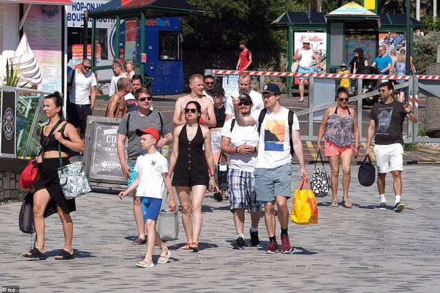 Groups of people begin to pour onto Bournemouth beach today where temperatures are expected to soar to 80.6F