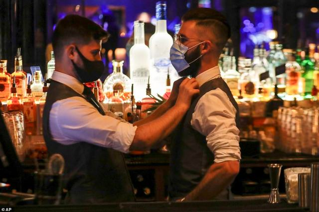 Nightclubs across the country have thrown open their doors to celebrate the arrival of Freedom Day. Pictured: Members of staff at The Piano Works club in Farringdon, London, preparing ahead of its re-opening as part of the relaxation of Covid-19 restrictions