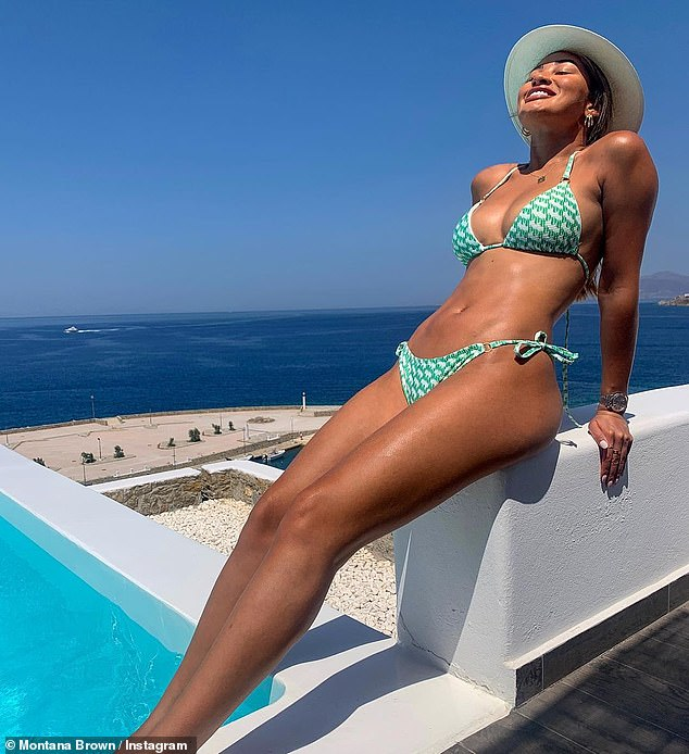 Sun kissed: Earlier in the week, the TV personality plugged in another bikini from her line as she posed in a skinny green two-piece