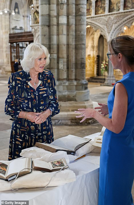 Camilla views some of the cathedral's historic artefacts