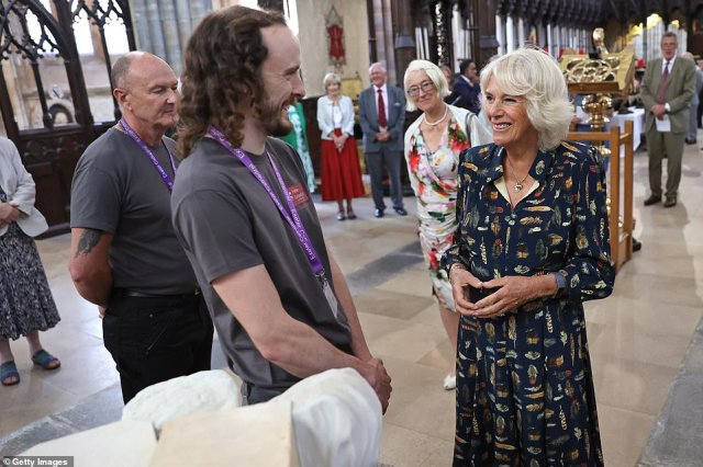 An animatedDuchess of Cornwall speaks with Exeter Cathedral staff during their visit on day one of their South West tour