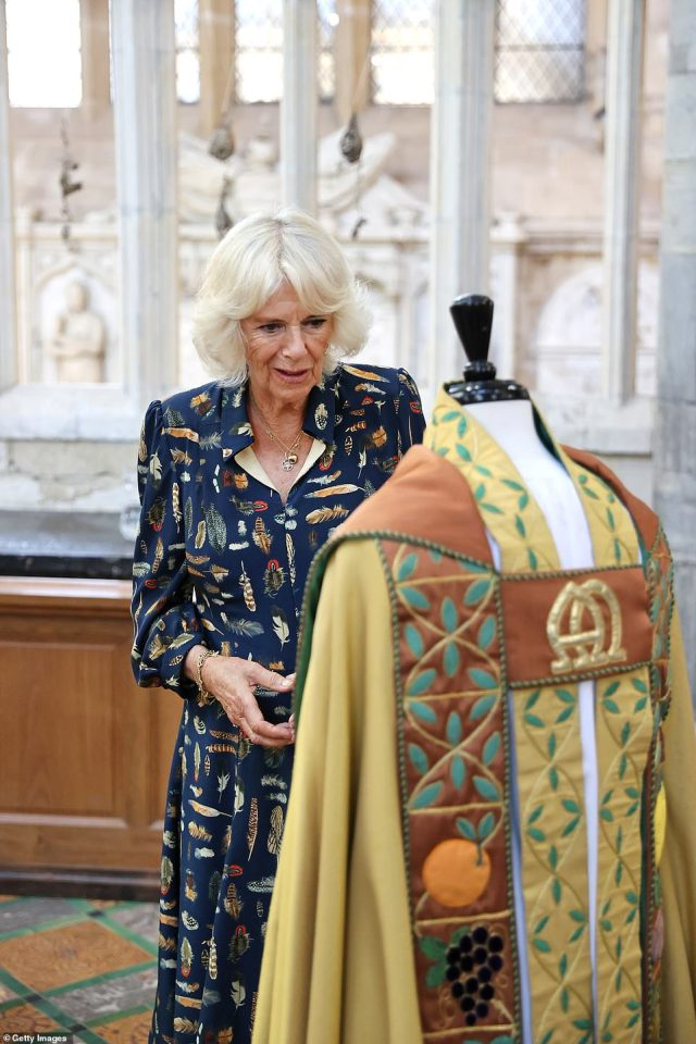 Camilla Parker Bowles is seen particularly admiring one of the cathedral's historic artefacts - a religious robe on a mannequin
