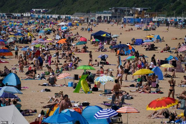 People enjoy the weather on Bournemouth beach in Dorset on what is expected to be the hottest day of the year so far