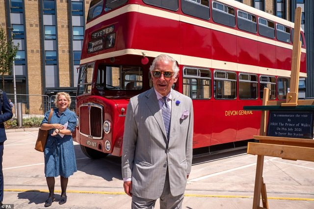 The Prince of Wales stood beside the number 3 Devon General bus which has been restored during his and Camilla's tour of the South West