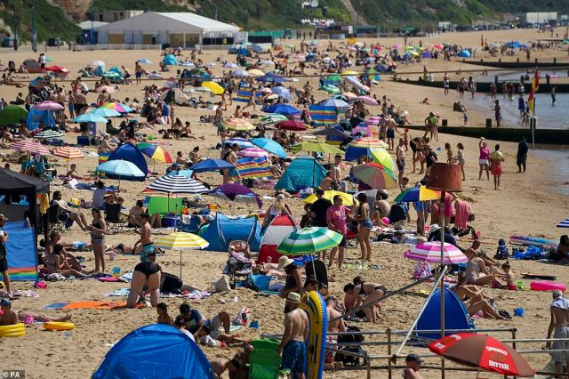 Sun lovers brought parasols and tents to keep themselves shaded and cool on the hottest day of the year on Bournemouth beach