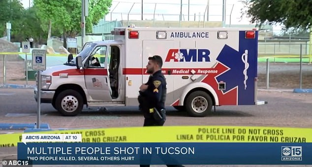 A paramedic riding in the ambulance was able to summon help, despite having been shot