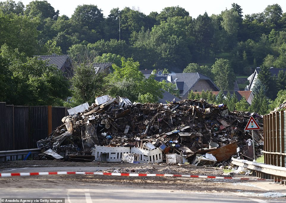 A pile of debris blocks a street inEuskirchen, western Germany, as the cleanup operation following floods gets underway