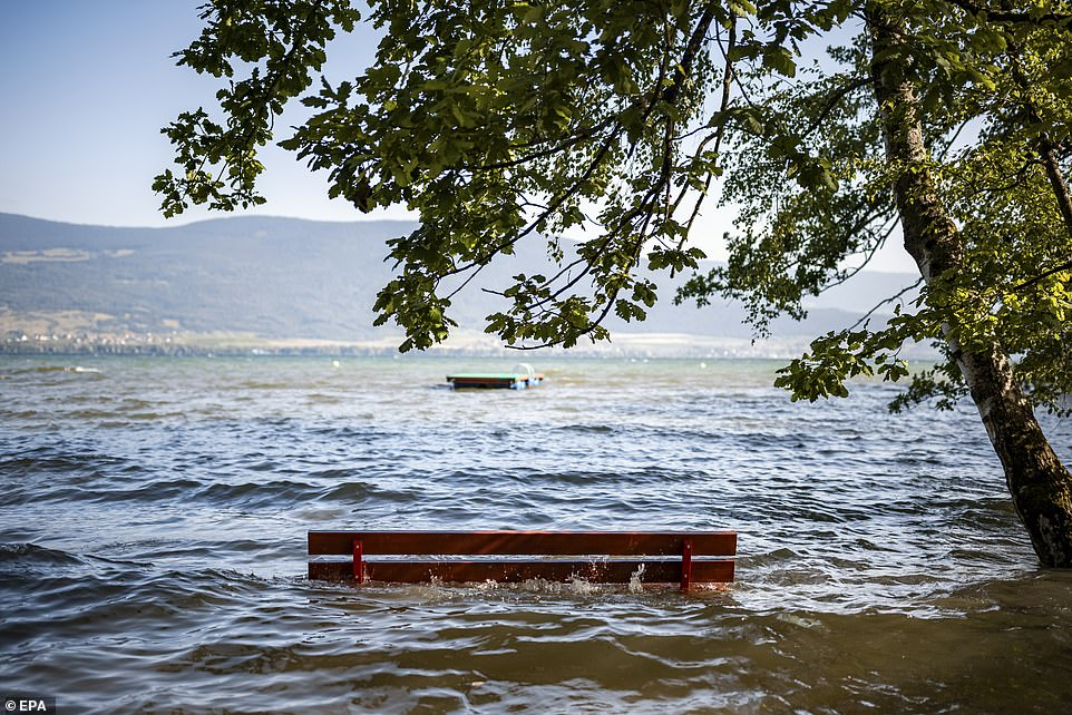 A bench that previously overlooked lake Neuchatel, Switzerland, is submerged after the water broke its banks