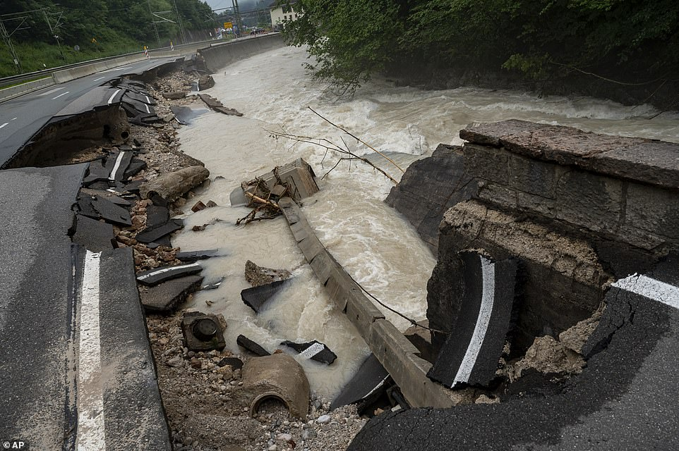 The remains of a road that was partially destroyed by rains is pictured in the Ramsauer Ache near Berchtesgaden, Germany
