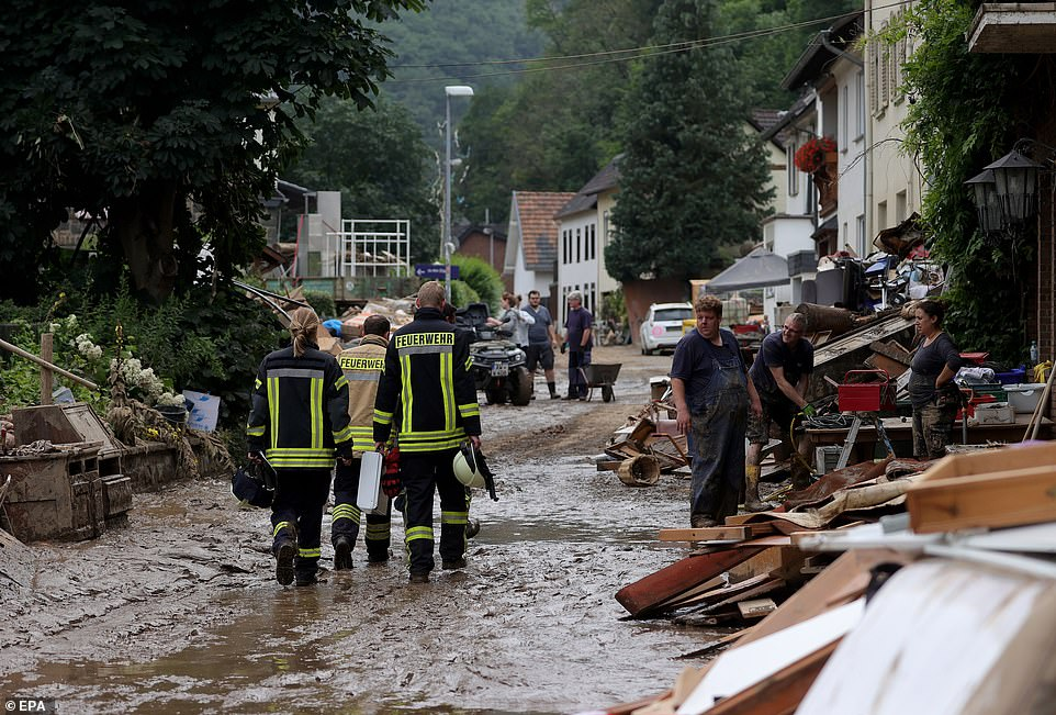 Firefighters inspect the streets and houses after the River Ahr broke its banks and caused widespread destruction last week