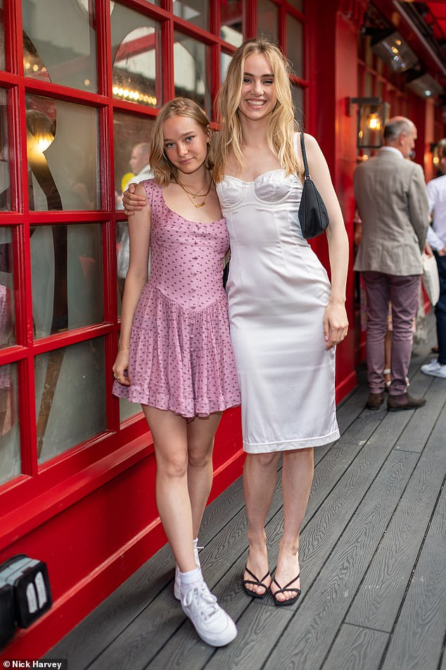 Wow: Suki led the stars at J. Sheekey's 125th birthday party in London on Monday (pictured with sister Maddi)