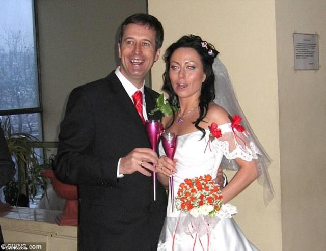 Barry Pring, who met his wife on a dating website, had been attempting to flag down a taxi to return home when he was struck down by an unknown driver in Kiev in 2008. A second inquest will try to find the cause of death after an unlawful killing was quashed by his wifeGanna Ziuzina in 2017 (pictured together on their wedding day in 2007)