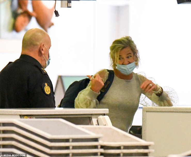 Controversial: Hopkins did not wear her mask properly as she went though security at Sydney Airport
