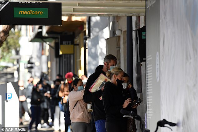 Queues stretched down the street at Centrelink offices on Tuesday as out-of-work Australians applied for relief payments (pictured in Darlinghurst)