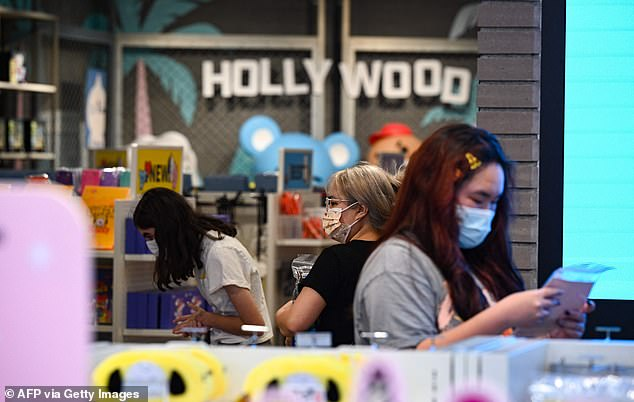 The recommendations come just one month after California dropped its coronavirus restrictions. Above, shoppers in a Hollywood store on July 19