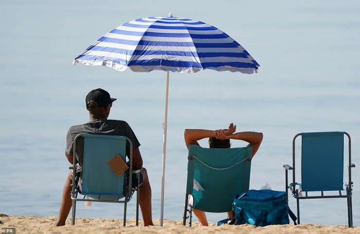 People enjoy the weather on Bournemouth beach in Dorset, with temperatures set to soar to sweltering highs this week