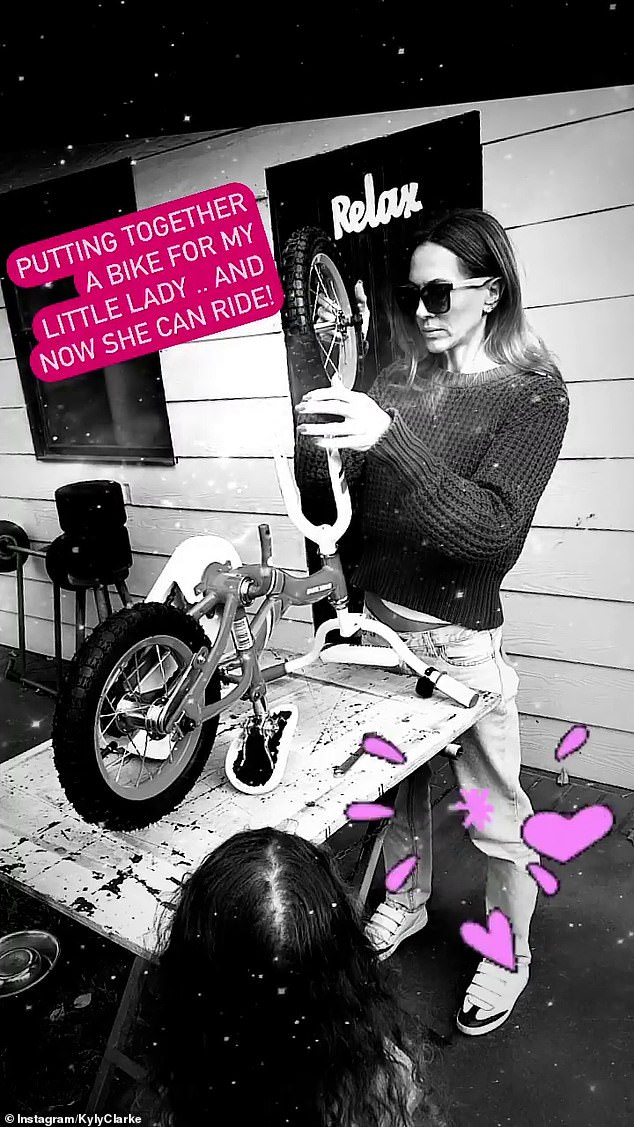 Is there anything she can't do? Kyly Clarke was every inch the DIY WAG as she built a bike for five-year-old daughter Kelsey Lee on Tuesday during Sydney's lockdown