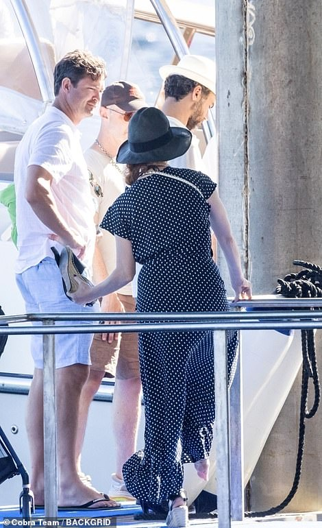 Nautucal: Jessica looked nautical in navy blue and white polkadot, keeping cool in her summer dress