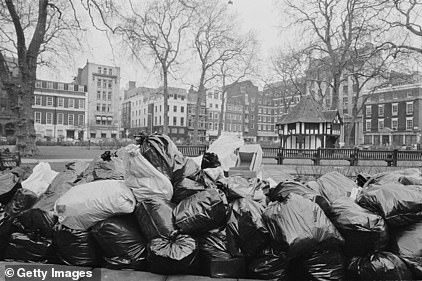 Rubbish piled up near Soho Square Gardens, London, during the 1979 Winter of Discontent