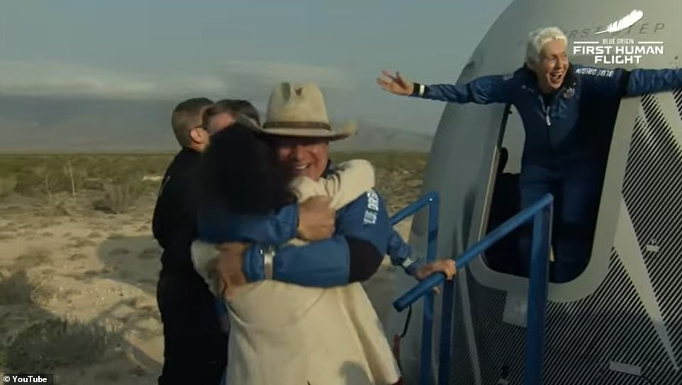 Jeff Bezos hugs a woman, believed to be his sister Christina, after returning to earth with his crew mates on Tuesday morning